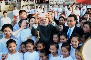 Prime Minister Narendra Modi with Chinese Premier Li Keqiang taking a selfie with children during a visit to the Temple of Heaven in Beijing on Friday. Credit: PTI Photo