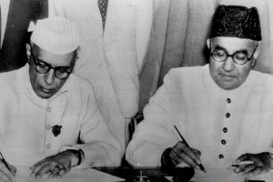 Archival photograph of Jawaharlal Nehru and Liaquat Ali Khan signing their 1950 pact for the protection of minorities.