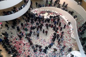 Artists of the G.U.L.F. campaign rain pamphlets about Gulf labour abuses into the rotunda of the Guggenheim in New York.