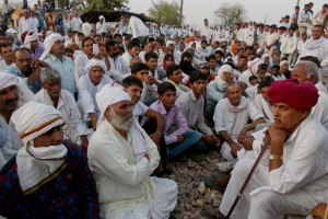 Bharatpur: Gujjar leader Kirori Singh Bainsla  with his community people as they  agitating to demand reservation in government jobs and educational institutions for their community on Delhi-Mumbai railway track near Bayana village in Bharatpur district of Rajasthan on Monday.PTI Photo(PTI5_25_2015_000271B)