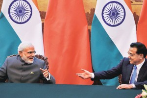 Prime Minister Narendra Modi with Chinese Premier Li Keqiang at the Great Hall of People in Beijing on Friday. (Credit: PTI)