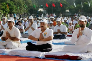Jammu: Minister of State (MoS) in PMO Jitender Singh, Dy.Chief Minister Nirmal Singh and others perform Yoga during a mass yoga session on the International Day of Yoga 2015 in Jammu on Sunday. Credit: PTI Photo