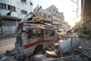Destroyed ambulance in the CIty of Shijaiyah in the Gaza Strip. Photo by Boris Niehaus (www.1just.de) - Own work. Licensed under CC BY-SA 4.0 via Wikimedia Commons