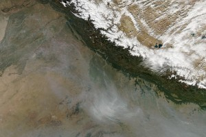 A photo taken by the NASA Aqua satellite shows a pall of smoke hanging over Uttar Pradesh as a result of crop-burning. Credit: NASA
