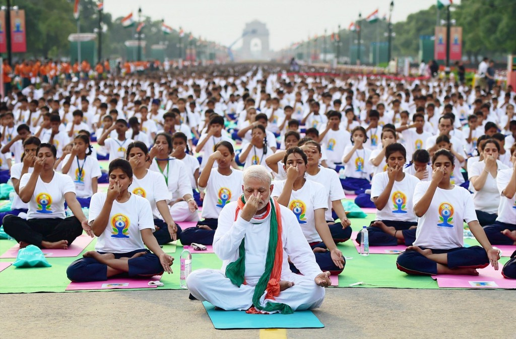 Prime Minister Narendra Modi at the mass yoga session on International Day of Yoga 2015 at Rajpath in New Delhi on Sunday. PTI Photo by Manvender Vashist