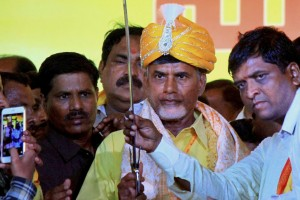 Chief Minister of AP N. Chandrababu Naidu being felicitated with a sword after he was elected as TDP's national president on the concluding day of the  'Party Mahanadu' at Gandipet near Hyderabad on Friday. PTI Photo.