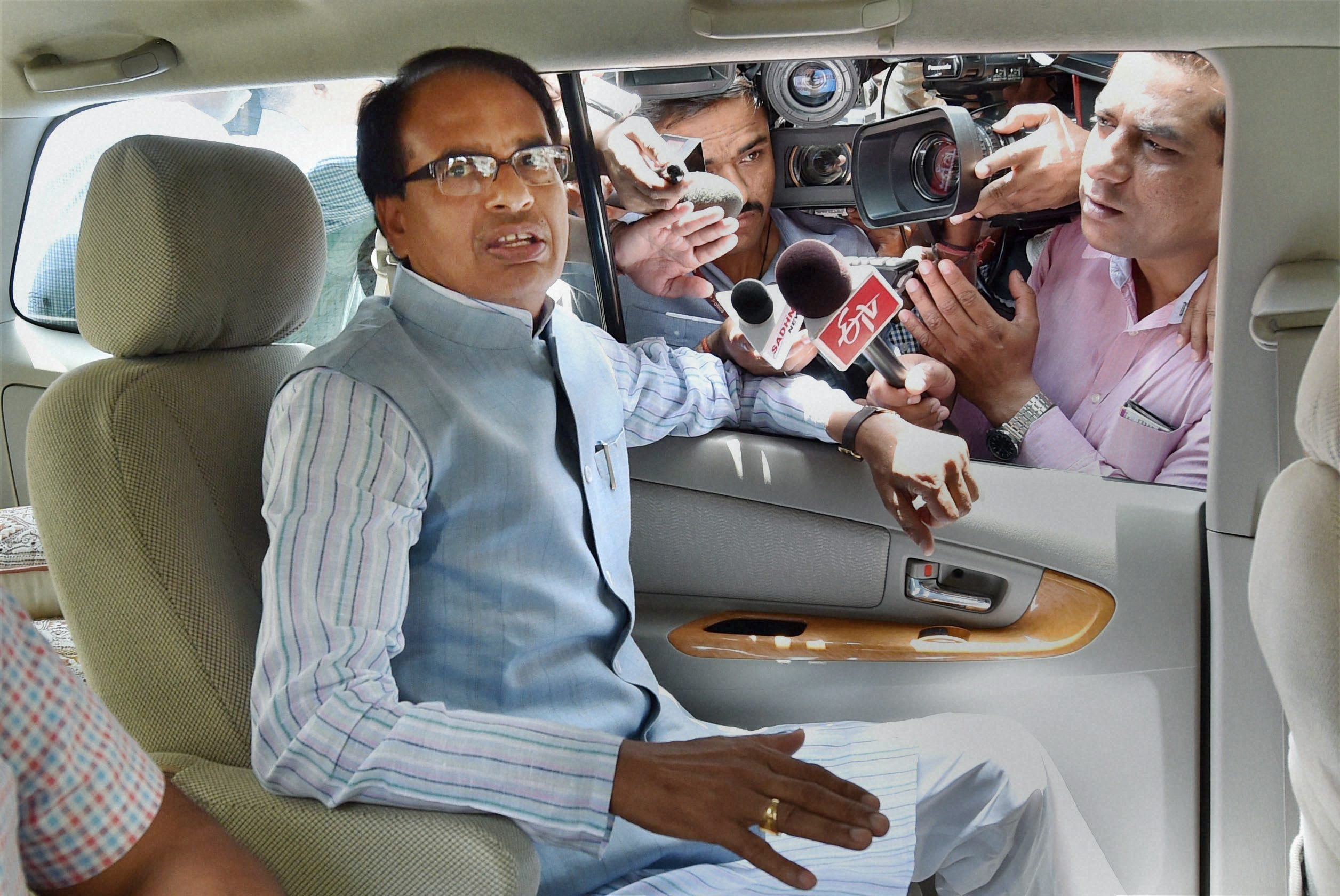 Madhya Pradesh Chief Minister Shivraj Singh Chauhan leaves after attending the 4th meeting of Chief Minister's sub group Niti Aayog meeting in New Delhi on Saturday. PTI Photo by Vijay Verma