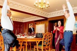 File photo of Ban Ki-Moon and his adviser Vijay Nambiar doing yoga. Credit: UN