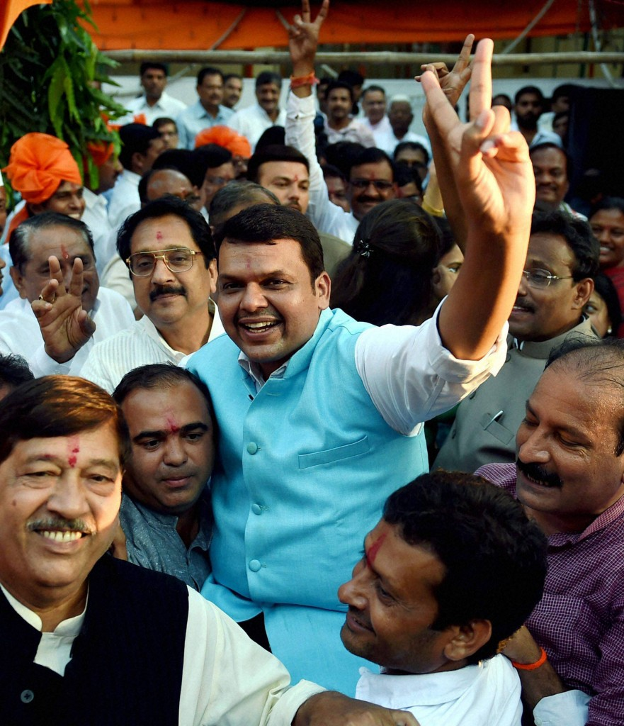 File photo of Maharashtra Chief Minister Devendra Fadnavis celebrating the BJP's victory in the Maharashtra Assembly elections . PTI Photo by Shashank