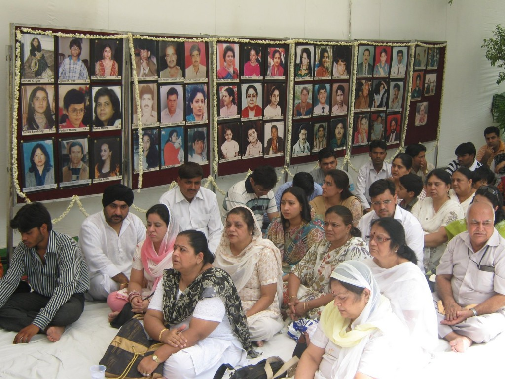 File photo of a prayer meeting of family members of the Uphaar cinema fire victims. Credit: AVUT