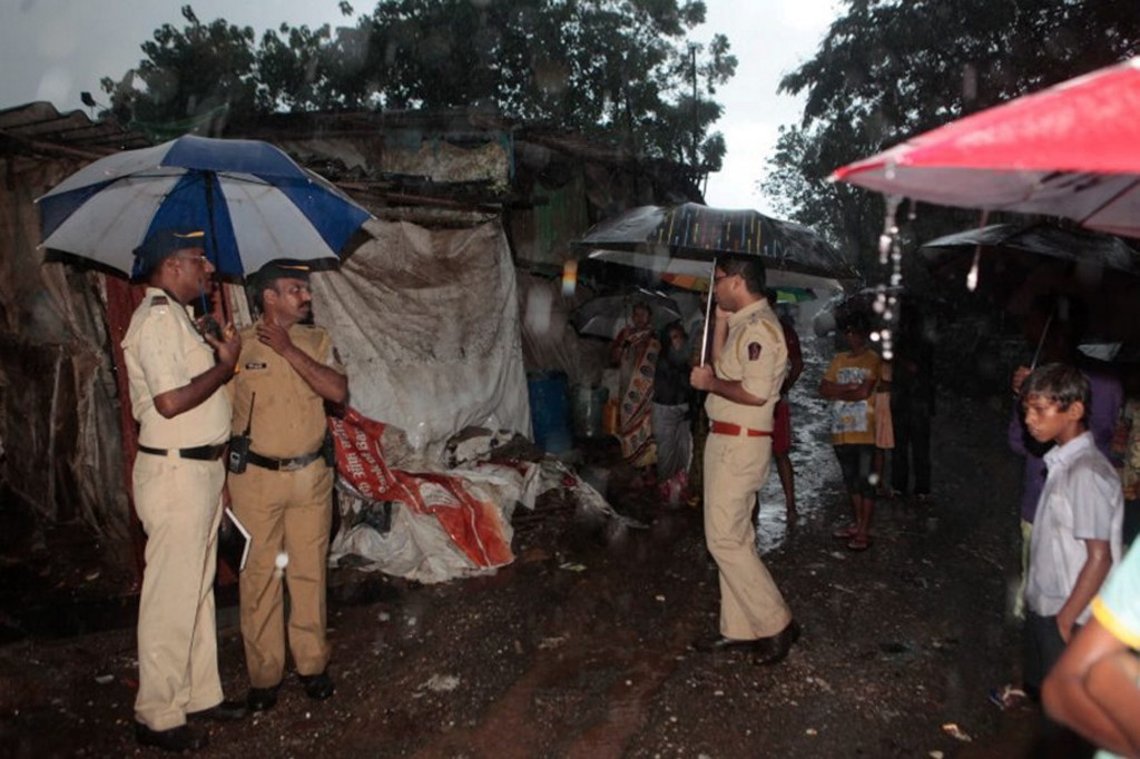 Police inspect the spot where the alcohol that killed 90 people at Malwani in Mumbai on Thursday. PTI Photo