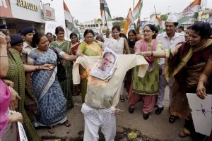 Mahila Congress activists burning an effigy of MP CM Shivraj Chouhan, demanding a CBI probe for his alleged involvement in the Vyapam scam. Credit: PTI Photo