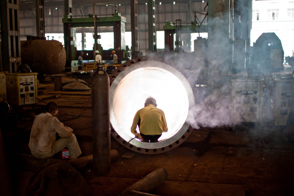 Welder in an Indian steel factory. Credit: jay Hariani, CC 2.0