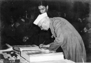Jawaharlal Nehru signing the Indian Constitution in 1950. Source: Wikimedia Commons