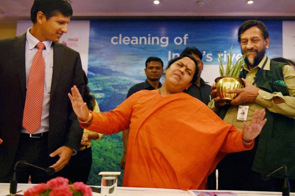File photo of Union Water Resources, River Development and Ganga Rejuvenation Minister Uma Bharti with RK Pachauri, Director General, TERI, and Venkatesh Kini, President, Coca-Cola India at the inauguration of the Department of Regional Water Studies at TERI University . PTI Photo by Subhav Shukla