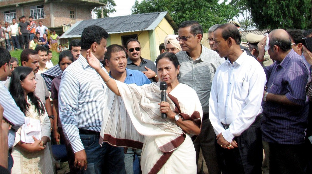 West Bengal Chief Minister Mamata Banerjee speaks to landslide victims at a relief camp in Darjeeling on Thursday. PTI Photo