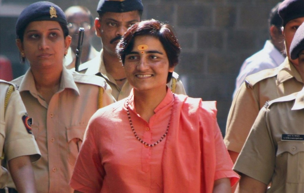 File photo from 2009 of Malegaon bomb blast accused Sadhvi Pragya Singh Thakur being taken to be produced in court  in Mumbai.  PTI Photo by Shirish Shete