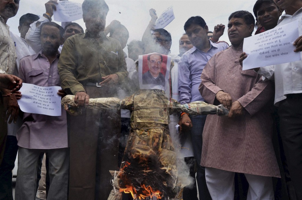 Congress activists burning an effigy of Madhya Pradesh Chief Minister Shivraj Singh Chouhan in Bhopal on Monday, They are demanding for a CBI investigation into the Vyapam or Madhya Pradesh Professional Examination Board scam. PTI Photo