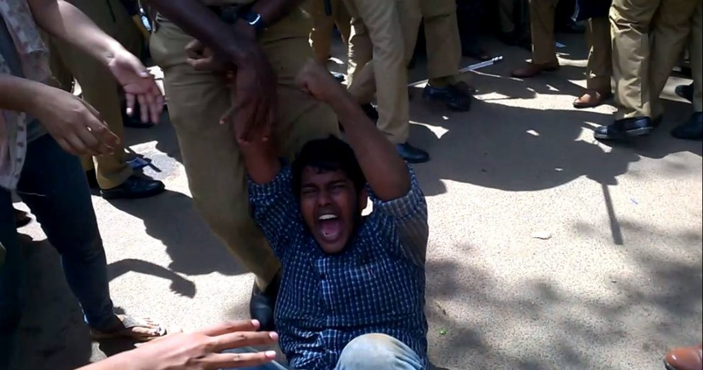 Police drag away a protesting student. Credit: PUSM