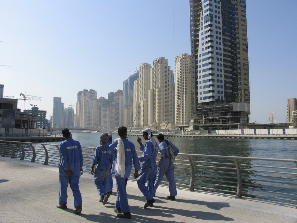 Indian workers taking a stroll on the Dubai Marina promenade. Credit: paulk/Flickr, CC BY 2.0