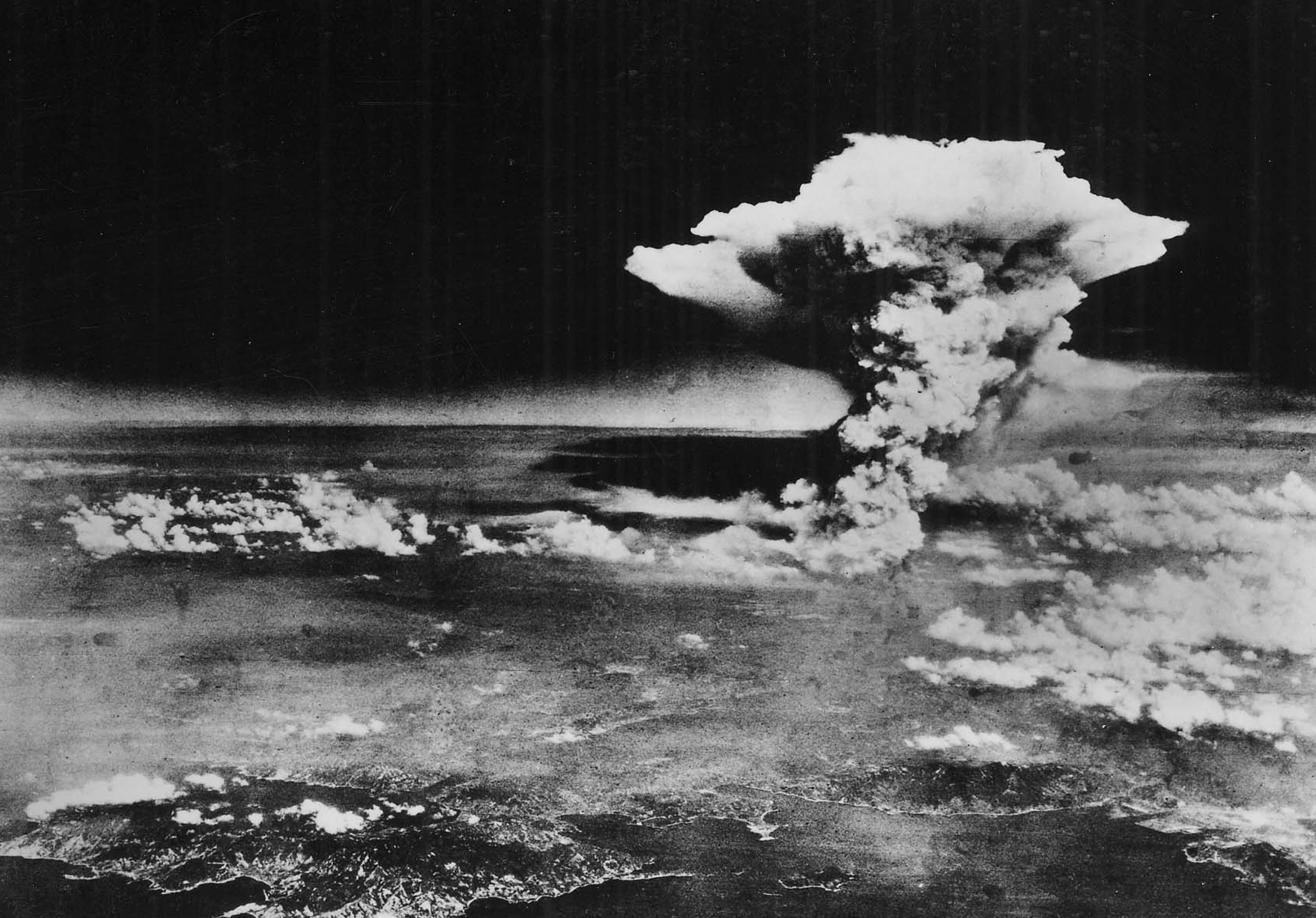 Atomic cloud over Hiroshima, photographed from the air after the United States dropped a nuclear bomb over the city on August 6, 1945.