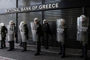 File photo of police in Athens guarding a shuttered bank. Credit: underclassrising/Flickr/CC BY-SA 2.0