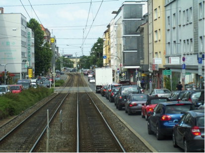 Tram line in middle of the road in Stuttgart, Germany, with limited space for cars. Credit: Dinesh Mohan