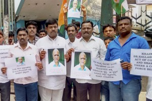 Youth Congress members protest against the killing of former Vice-Chancellor of Hampi University M M Kalburgi who was shot dead at his Kalyanagar residence by unidentfied gunmen in Dharwad on Sunday. Credit: PTI