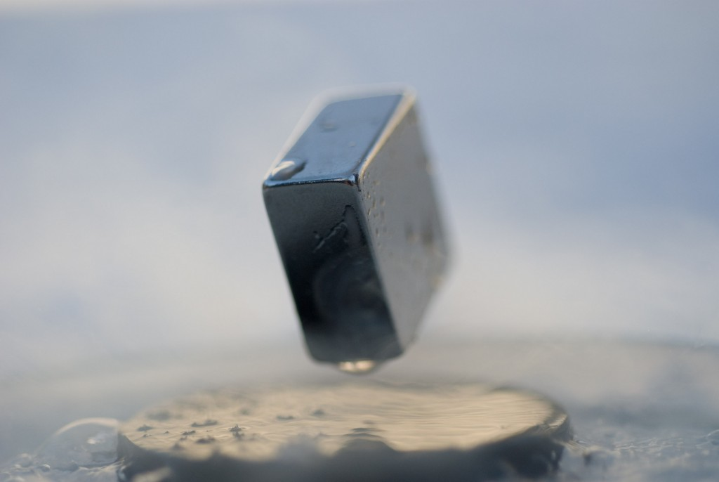 A magnet levitating on top of a superconductor. Credit: Wikimedia Commons