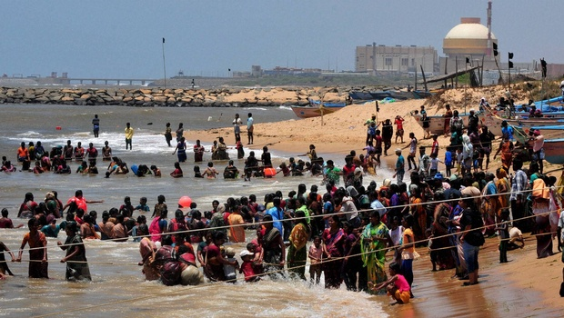 File photo from 2012 of ativists and residents standing in the Bay of Bengal waters as they protest against the Koodankulam Atomic Power Plant in Tamil Nadu. Credit: PTI