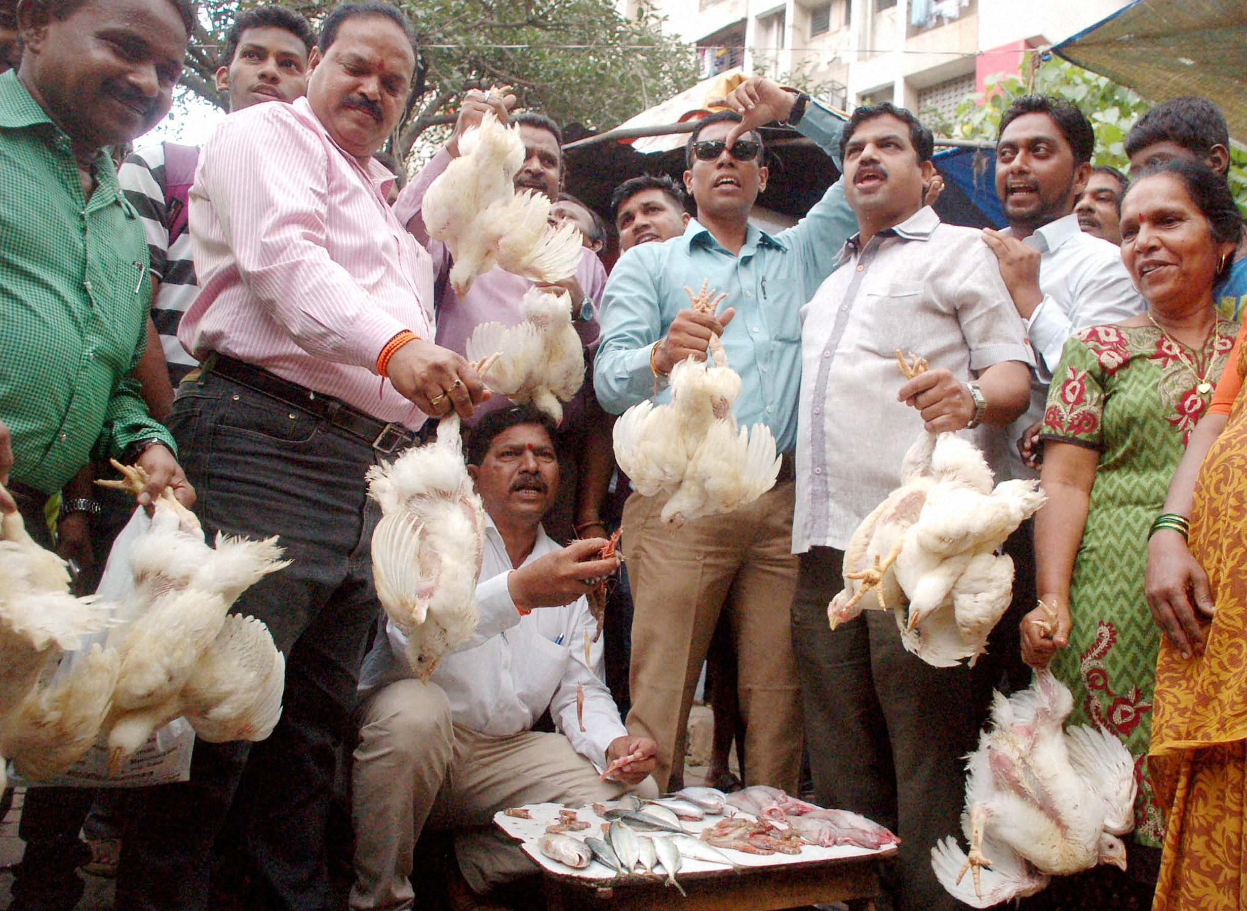 Shiv Sena workers hold chickens during a protest against ban on meat in Mumbai last week. Credit: PTI