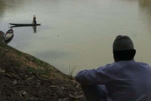 Sirajuddin and the lone boatman. Still from the film. Credit: Subasri