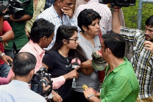 Reporters badger Indrani Mukerjea's daughter Vidhi (in black) as she arrives at Bandra Metropolitan Magistrate's court in Mumbai on Monday. Credit: PTI Photo by Shashank Parade