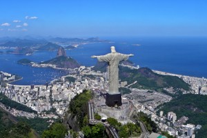 A panoramic view of Corcovado Mountain with the statue of Christ the Redeemer in the foreground. Credit: Wikimedia Commons
