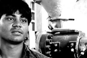 23-year-old Ravi hails from Aligarh, Uttar Pradesh. He oper- ated an injection-molding machine in a small tier-3 factory that manufactures spare parts for heavy vehicles. On his fifth day on the job, there was an unexpected malfunctioning of the machine and it closed down on its own. Before he could switch off the machine, Ravi's hand got caught in the machine and he lost four fingers and part of his left palm. The employer paid for his treatment but is now demand- ing a return of the treatment expenses. The employer also refuses to give his salary on time and is instead coercing Ravi into handing over the ESI com- pensation payment.