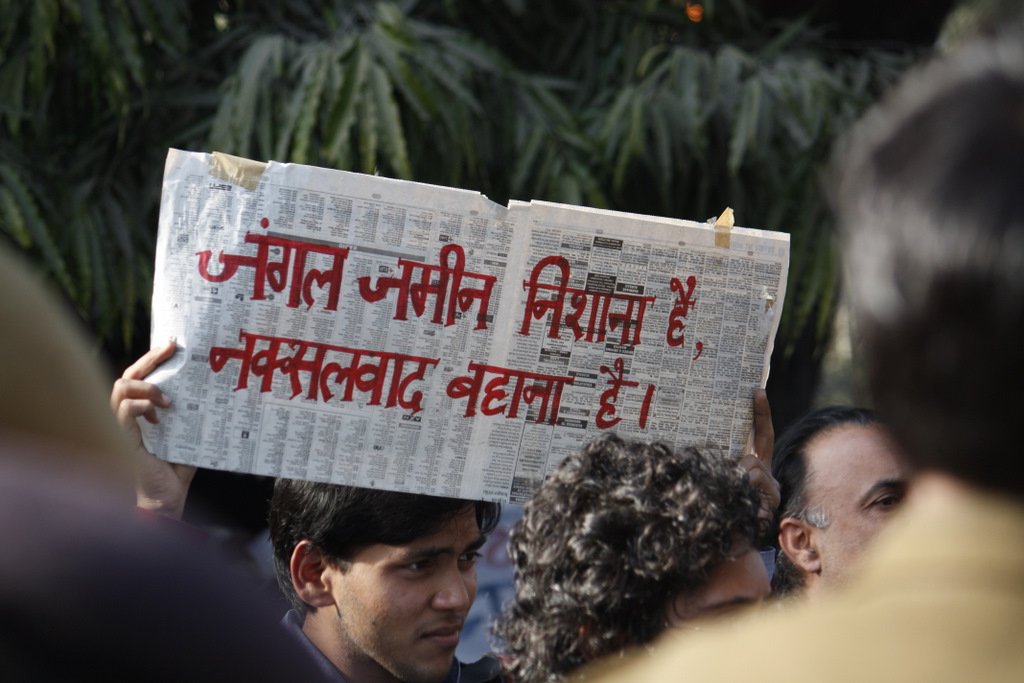 File photo of a protestor accusing the police of using naxalism as an excuse to arrest people. Credit: Joe Athialy/Flickr CC  BY-NC-SA 2.0