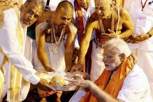 Prime Minister Narendra Modi being being offered prasad at the Lord Venkateswara temple at Tirumala in Tirupati on Thursday. Credit: PTI