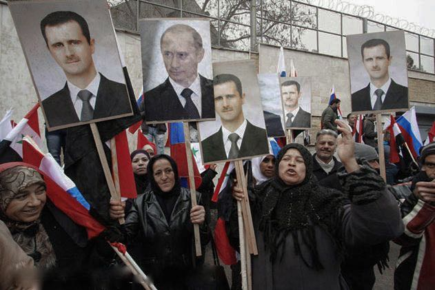 File photo from 2012 of Syrians holding photos of Assad and Putin during a pro-regime protest in front of the Russian embassy in Damascus, Syria. Credit: Freedom House/Flickr CC 2.0