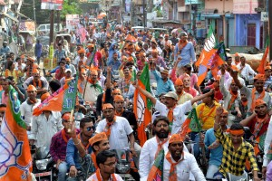 BJP activists take out a road show  for the second phase of assemply elections in Gaya on Wednesday. Credit: PTI