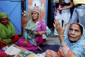 Relatives mourn the death of farmer Mohammad Akhlaq at his home in Bisara village in Dadri, Uttar Pradesh, about 45 kilometers from New Delhi on Wednesday. Villagers beat Akhlaq to death and severely injured his son upon hearing rumours that the family was eating beef. Credit: PTI