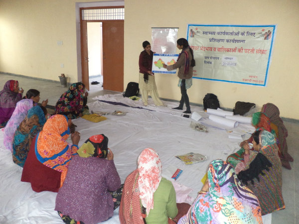 Training for frontline workers in Narsinghpura gram panchayat, a village of 1,029 people, 15 km west of Jaipur. Workers–and families–held several myths. Two examples: Girls do not need nutrition and healthcare, and that immunisation causes a girl to be born. Credit: Devanik Saha