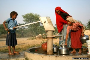 Girls collect water from a well in Rajasthan, India. The dam Save the Children built has recharged the ground water sources around the village and the well. Source: Save the Children/Flickr