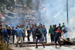 Protesters throw stones on police during clashes which erupted  after the funeral of 24-year-old truck driver Zahid Rasool, who was injured in the patrol-bomb attack on a truck in Udhampur, at Batango in Anantnag district of South Kashmir. Credit: PTI