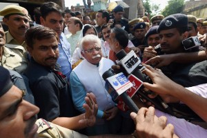 Haryana Chief Minister Manohar Lal Khattar talks to media during a visit to Sunpedh village where a dalit's house was set on fire allegedly by men belonging to the upper-caste community, in Ballabhgarh in Faridabad on Thursday. Credit: PTI Photo by Manvender Vashist
