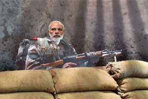 Prime Minister Narendra Modi behind a soldier's cut-out at 'Shauryanjali', a commemorative exhibition on Golden Jubilee of 1965 war at India Gate. Credit: PTI Photo by Vijay Verma