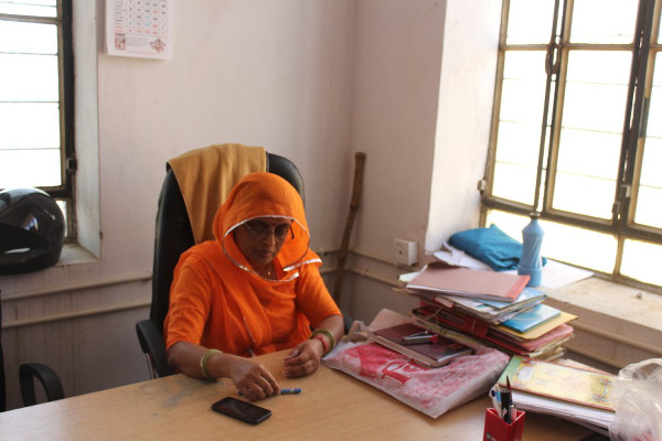 Vinita Rajawat, sarpanch of Dolatpura Kotda, a panchayat of 6,034 people in Northern Rajasthan in her office. Every time a girl is born, she opens a bank account for the girl and deposits Rs.200. Credit: Devanik Saha