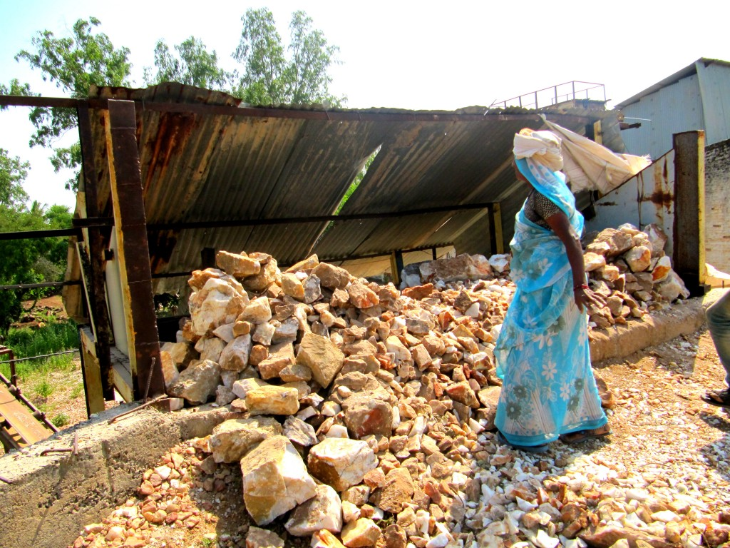 A woman worker in a crusher unit without safety gear. Women here are paid less than the official minimum wages in Gujarat. Credit: Neha Dixit