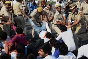 Police detain students who were protesting at the University Grants Commission (UGC) headquarters in New Delhi on Friday against the scrapping of fellowship awarded so far to non-National Eligibility Test (NET) research scholars. Credit: PTI