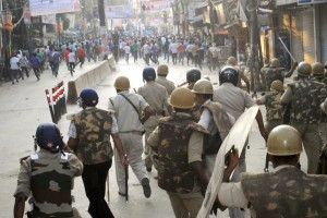 Police in action against protesters during a violent clash in Varanasi on Monday. The clashes broke out during a demonstration by sadhus and devotees against the September 22 police baton-charge on a procession where they were heading to immerse Ganesha''s idol in the Ganga. Credit; PTI