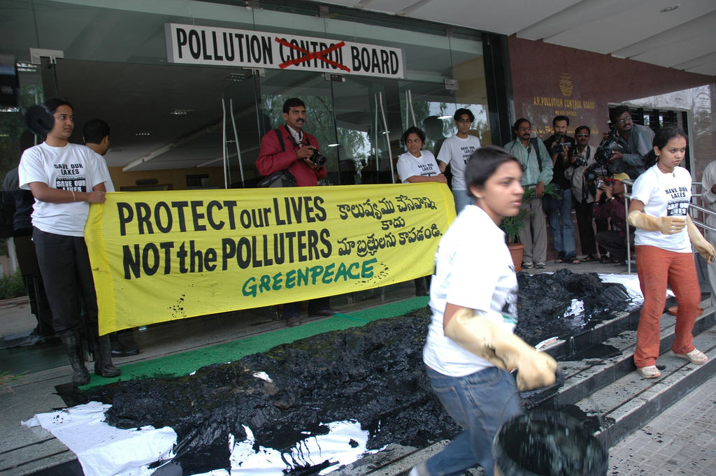 Greenpeace activists dump nearly one ton of toxic sludge from the Asanikunta Lake in Medak District, at the doorstep of the APPCB in Hyderabad (File photo). Credit: Greenpeace India